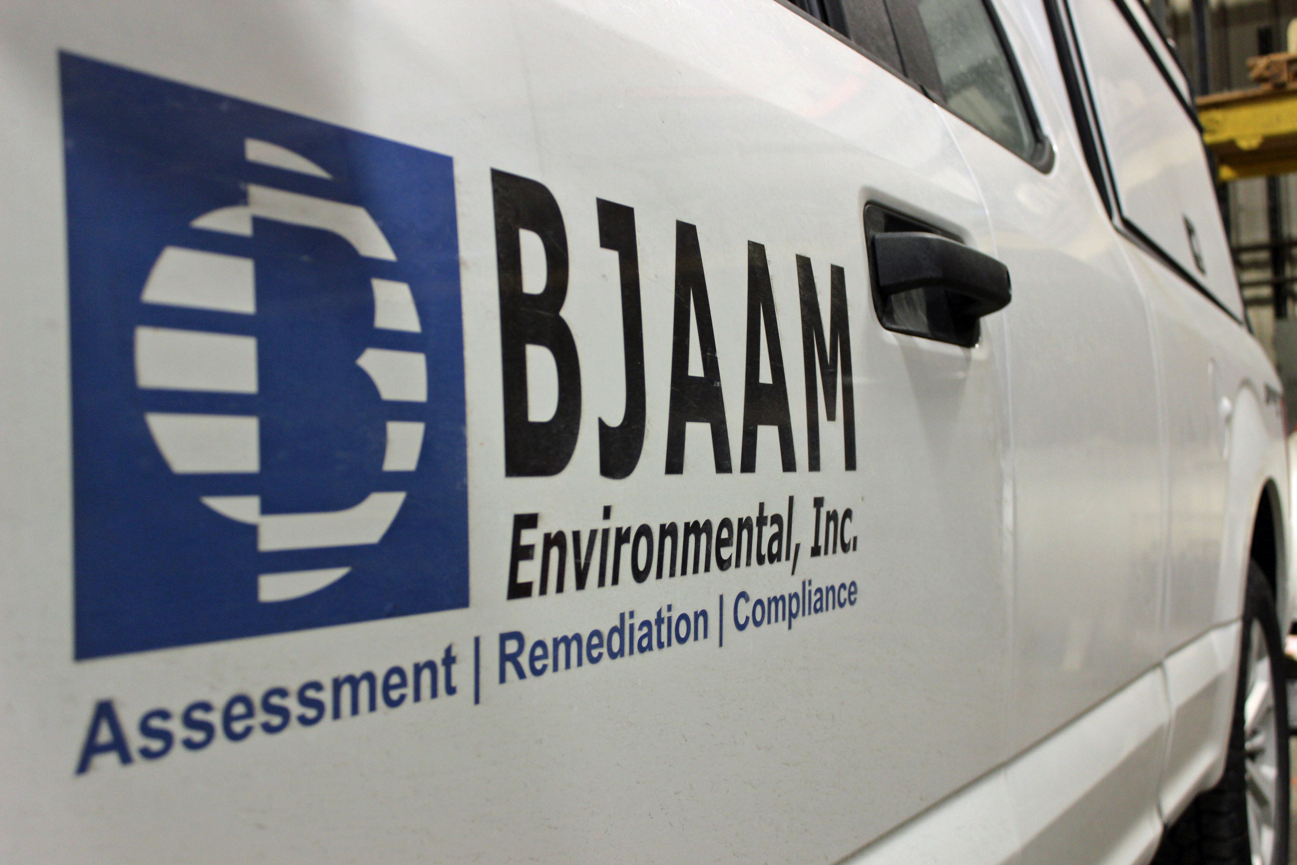 White pickup truck with BJAAM logo on the door