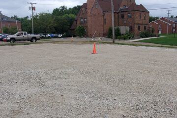 Clean, gravel lot with BJAAM safety cones