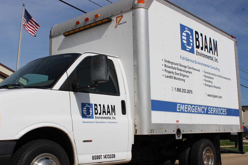 White box truck with BJAAM logos on it and lists of services BJAAM offers on the side of the box