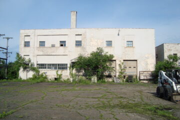 Old industrial building overgrown with vegetation