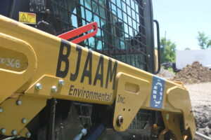 Close-up of skid steer with BJAAM logo